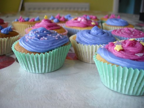Vanilla sponge cupcakes with icing.Decorated with sugar stars